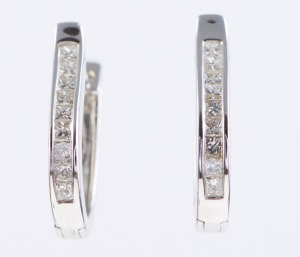 A PAIR OF DIAMOND HOOP EARRINGS
