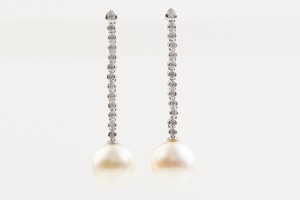 A PAIR OF SOUTH SEA PEARL AND DIAMOND DROP EARRINGS