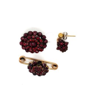TWO GARNET SET VICTORIAN BROOCHES AND A SINGLE EARRING