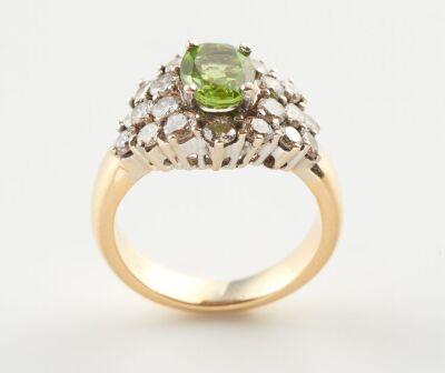 A PERIDOT AND DIAMOND CLUSTER RING,