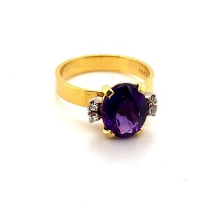A RETRO AMETHYST AND DIAMOND SET DRESS RING