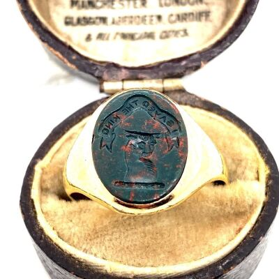 A BLOODSTONE SET SIGNET RING