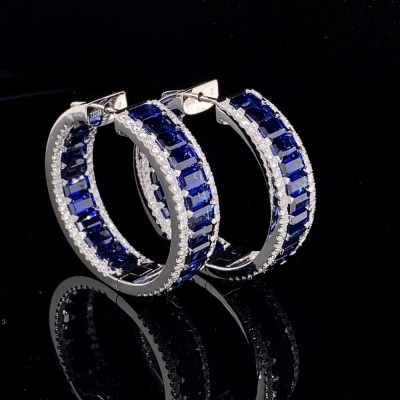 AN IMPRESSIVE PAIR OF SAPPHIRE AND DIAMOND EARRINGS