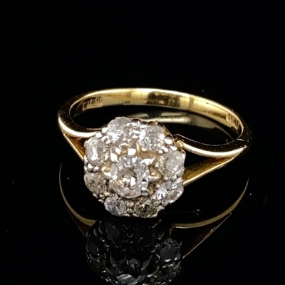 AN ANTIQUE AUSTRALIAN DIAMOND CLUSTER RING BY WILLIAM DRUMMOND