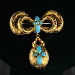 AN ANTIQUE AUSATRALIAN TURQUOISE SET MORNING BROOCH