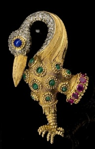 A WHIMSICAL VINTAGE GEM SET BIRD BROOCH