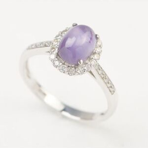 A STAR SAPPHIRE AND DIAMOND RING